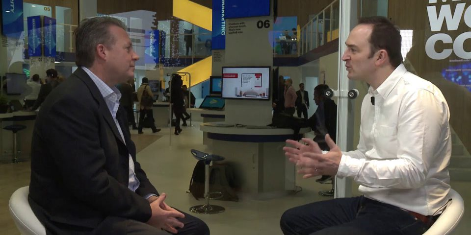 Tom Cheesewright, futurist speaker, interviewing an executive from Accenture at Mobile World Congress